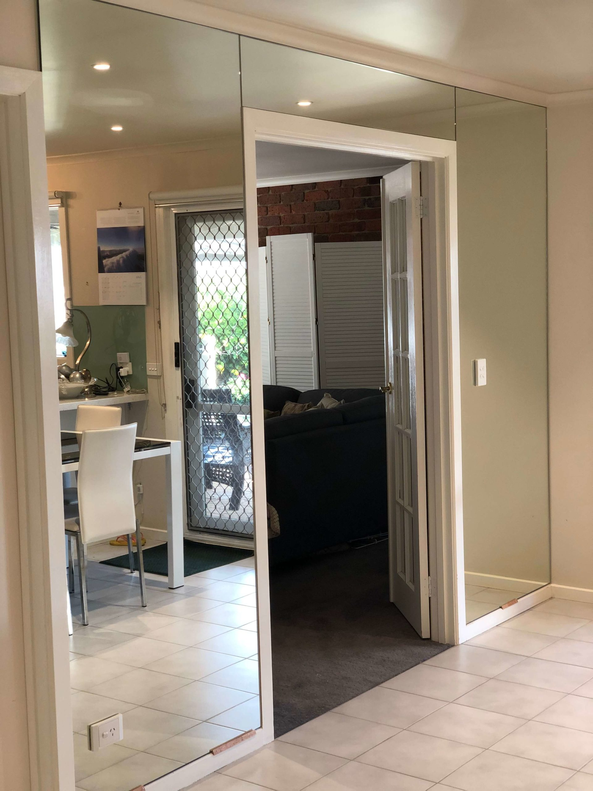 Large Mirrors Fitted Around Door